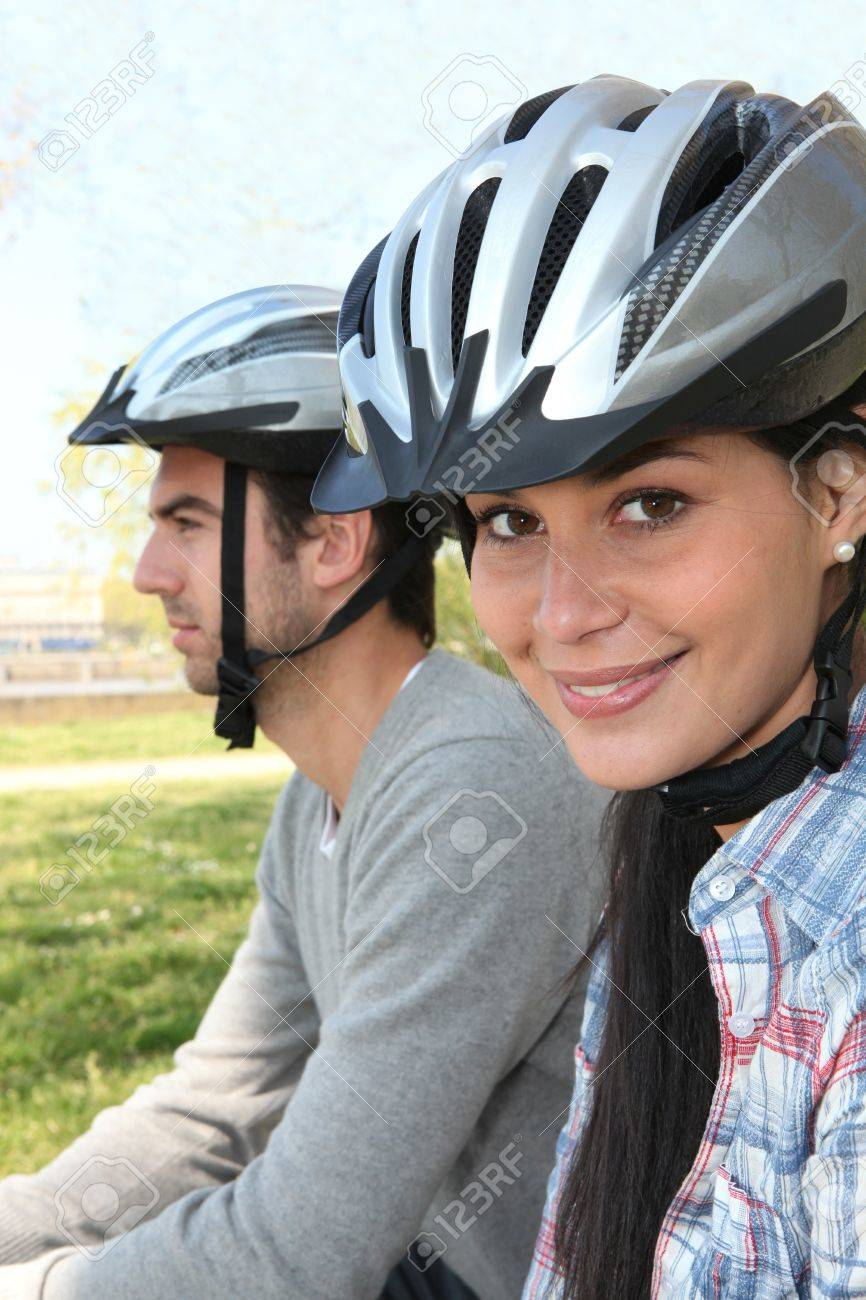Young couple wearing cycle helmets Stock Photo - 12090761