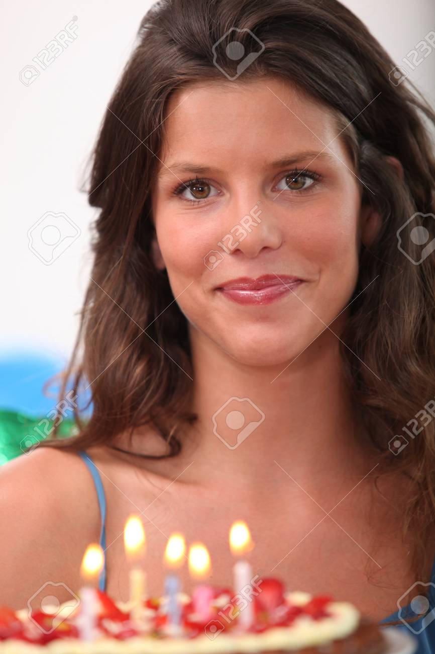 Woman with a birthday cake Stock Photo - 12089728