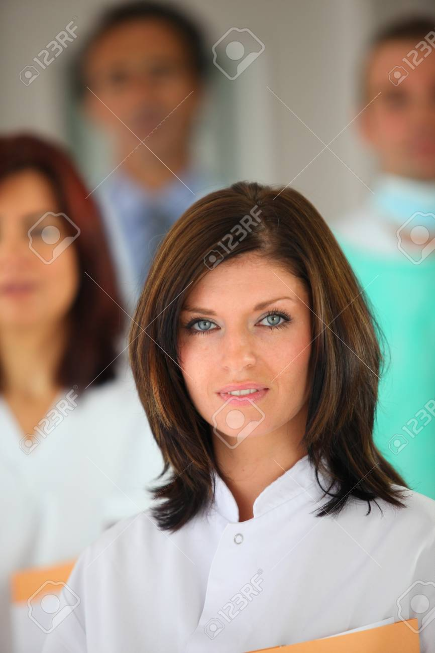 portrait of young female background with medical team in background Stock Photo - 12091905