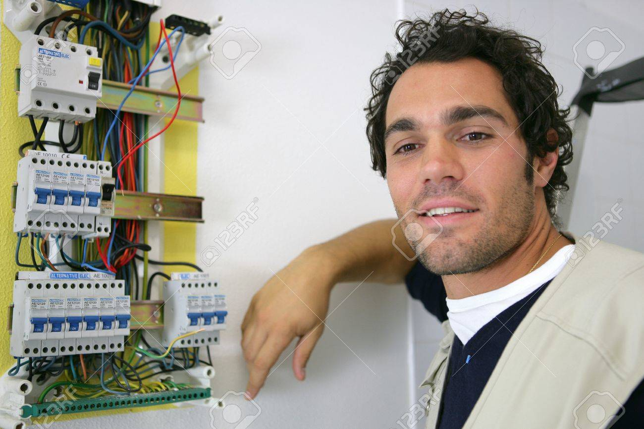 young electrician posing near electric meter Stock Photo - 12132998