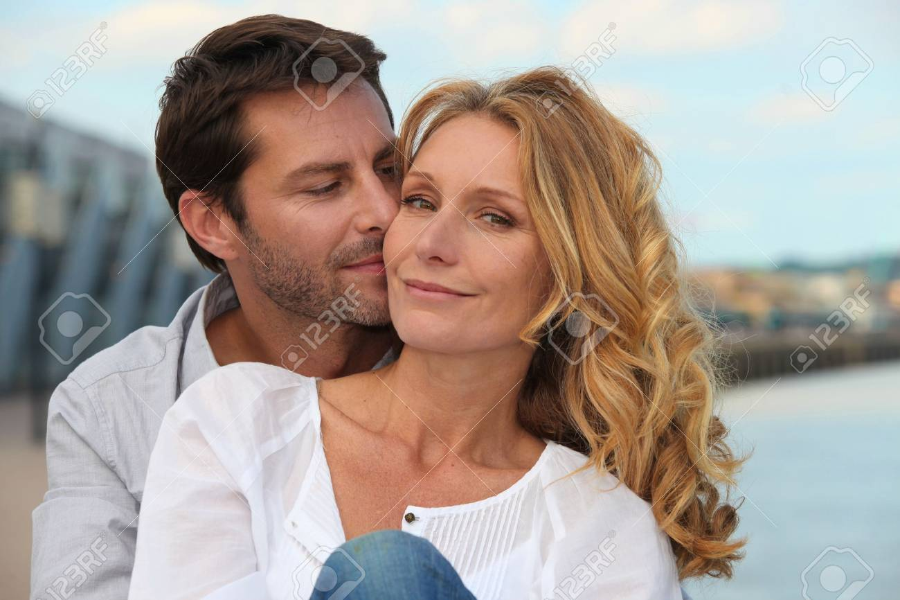 Portrait of a couple by the sea Stock Photo - 12133022