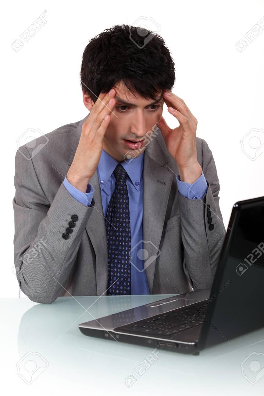 A businessman having a headache. Stock Photo - 12133161
