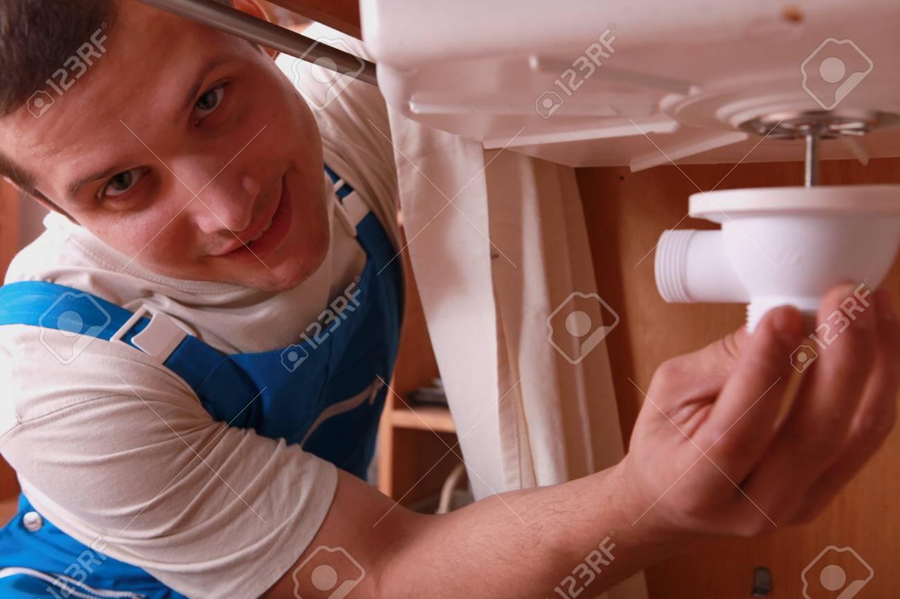 Plumber repairing sink Stock Photo - 12218232