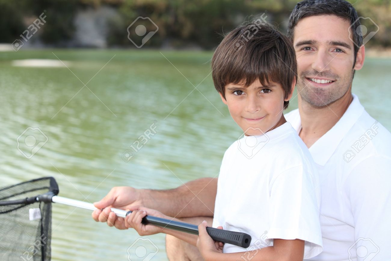 Father and son fishing on boat Stock Photo - 12218229