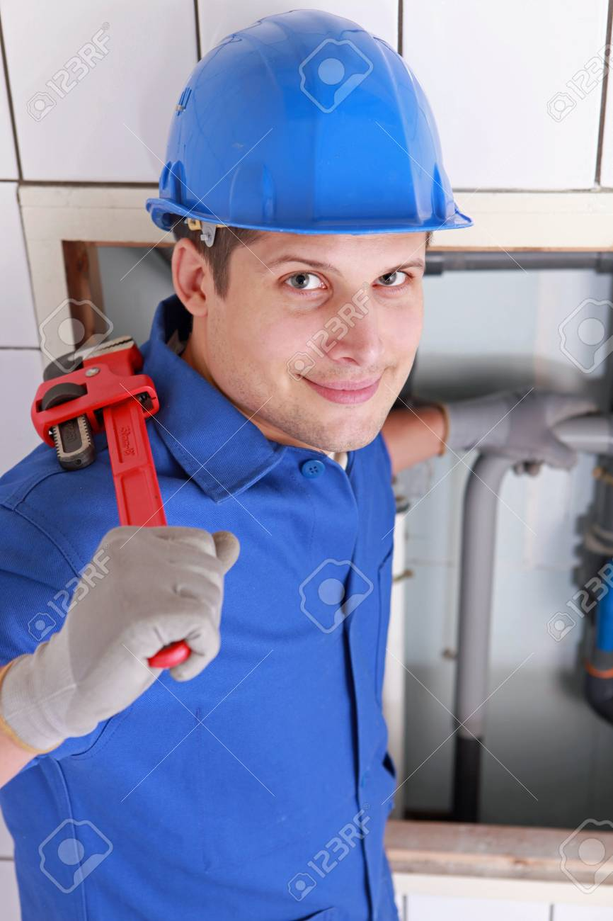 Plumber installing pipes with a large wrench Stock Photo - 12219411