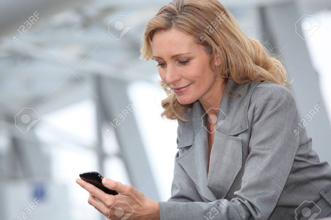 Businesswoman with mobile phone Stock Photo - 12219741