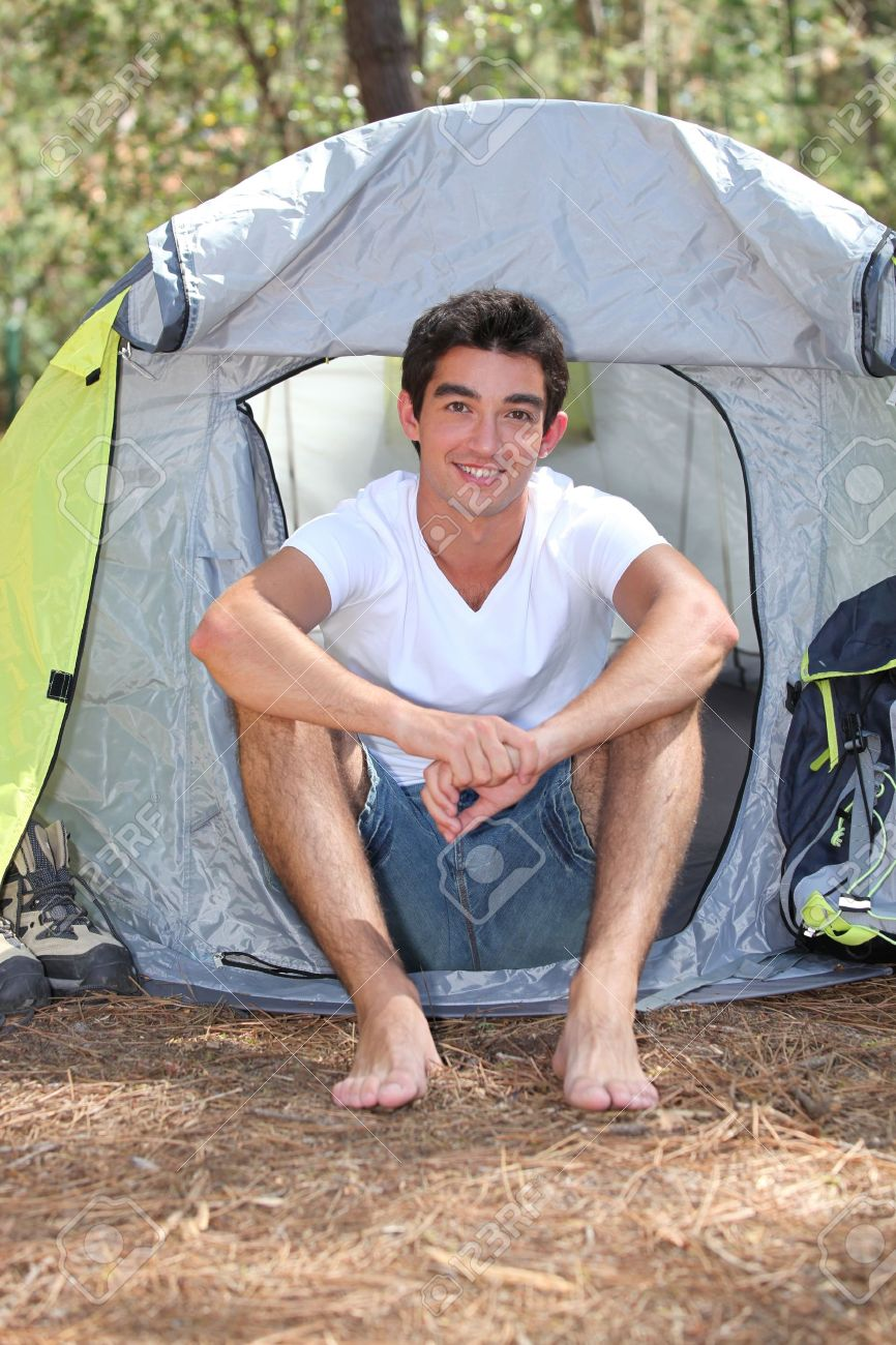 Teenage boy sitting in front of his tent on a sunny day Stock Photo - 12219928