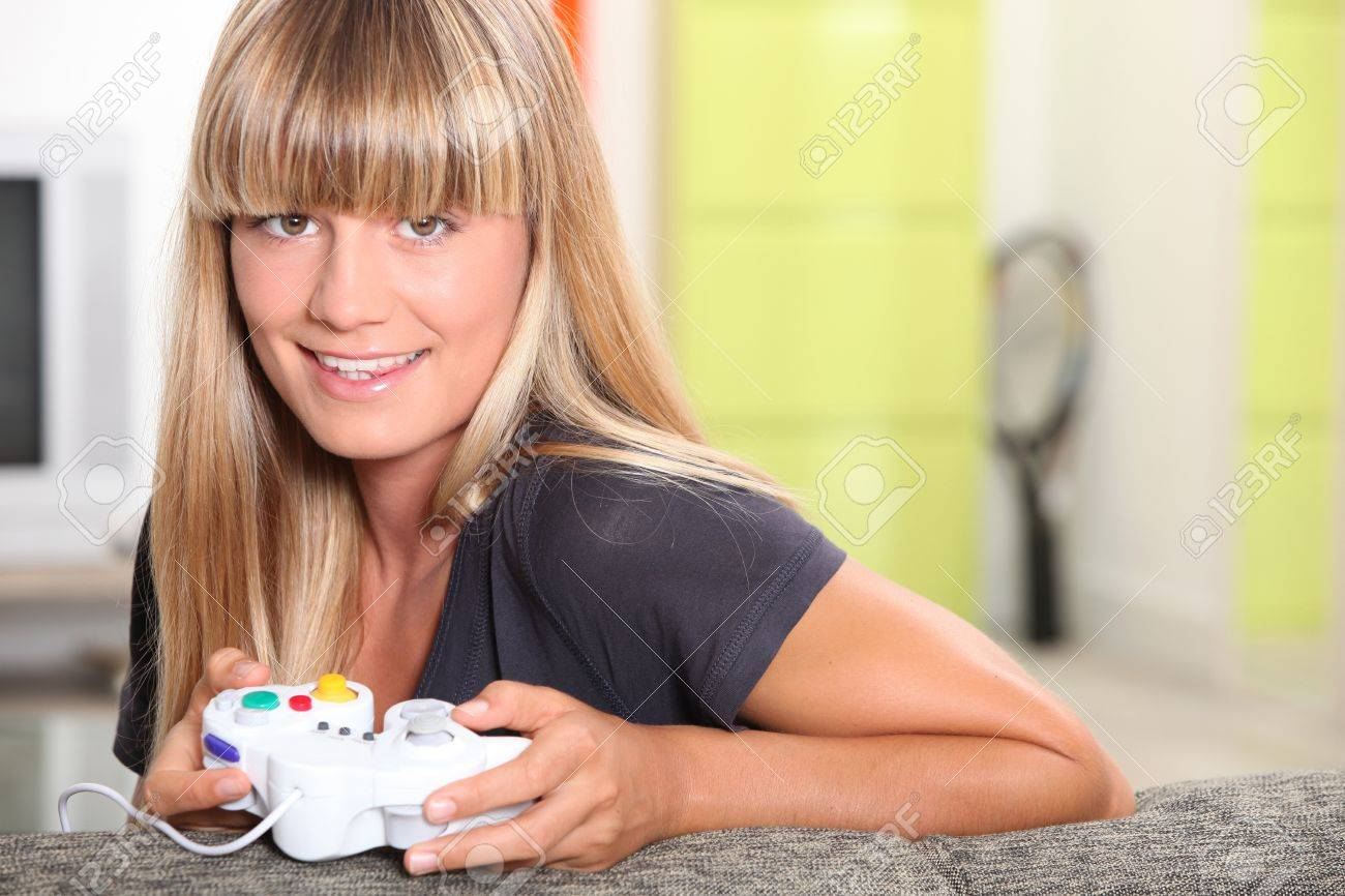 Blond Teenager Playing Video Games Stock Photo 12219795