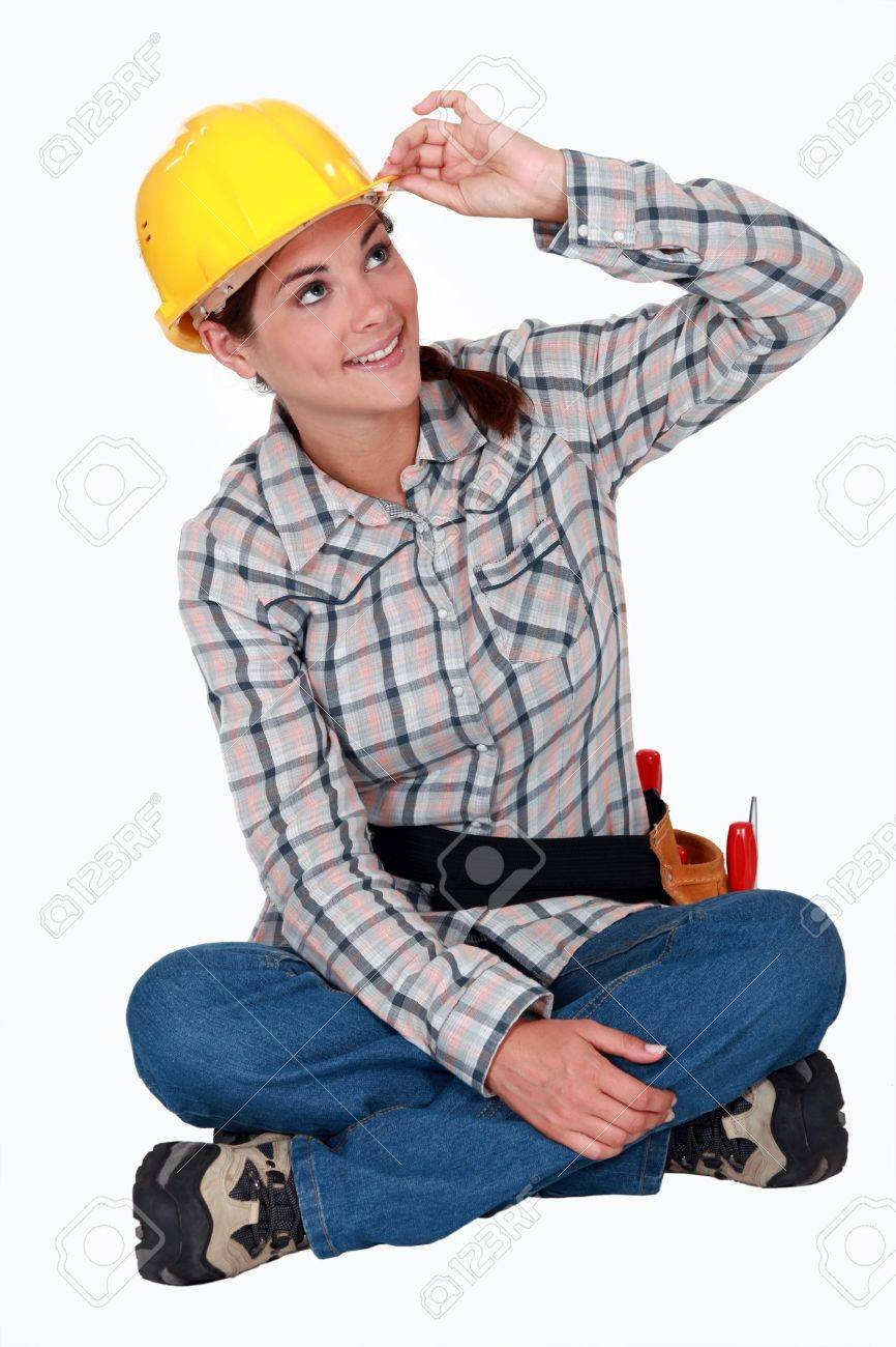 Tradeswoman touching the brim of her hat Stock Photo - 12219548