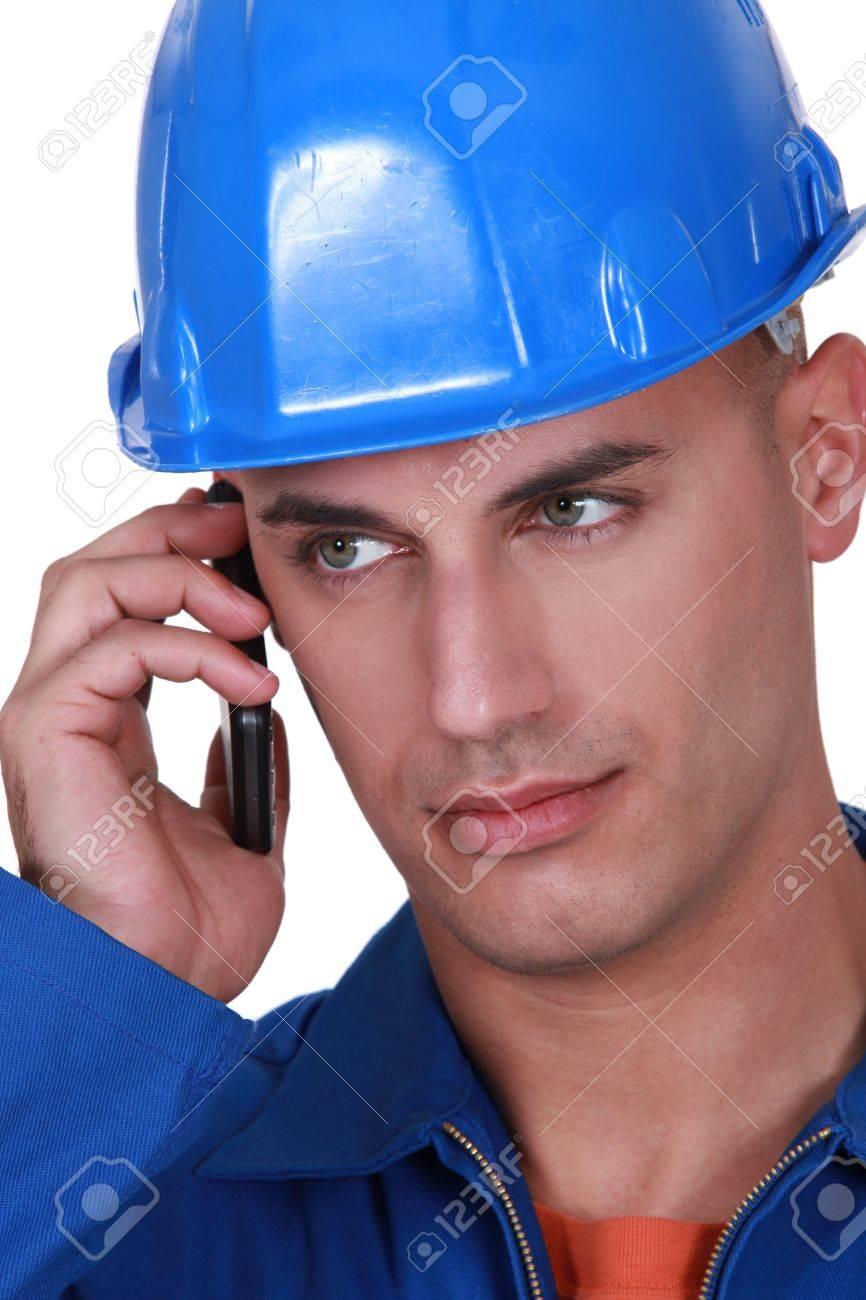 Tradesman talking on his mobile phone Stock Photo - 12249767