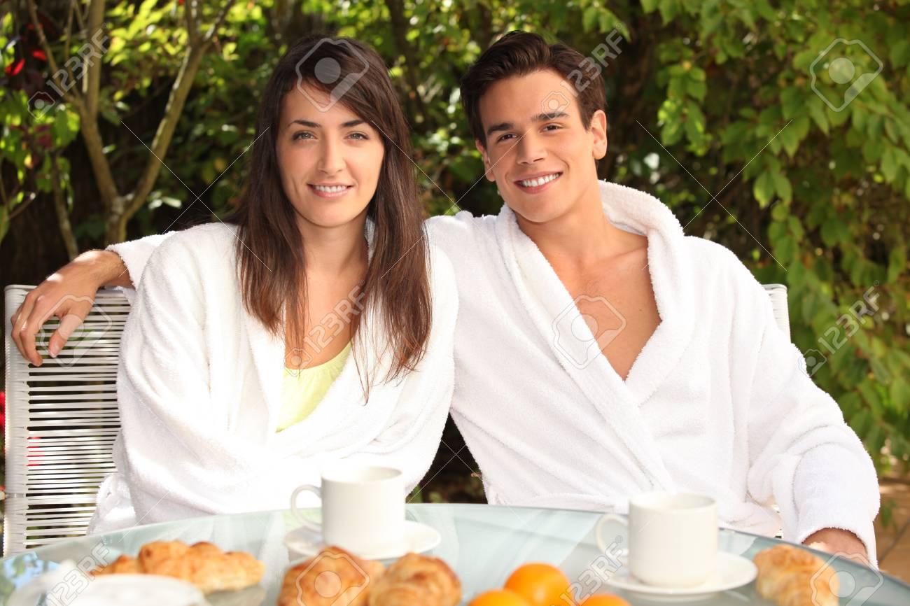 Young couple having breakfast outside Stock Photo - 12250161