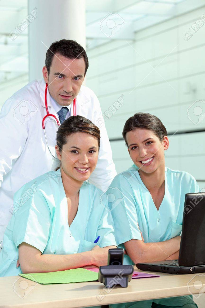 Physician and female nurses Stock Photo - 12250285