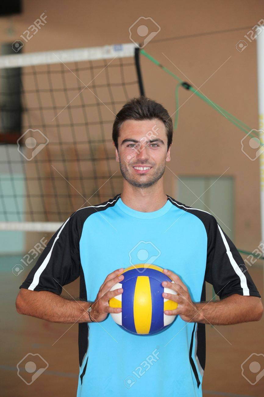 Volleyball player with ball in front of net Stock Photo - 12250333