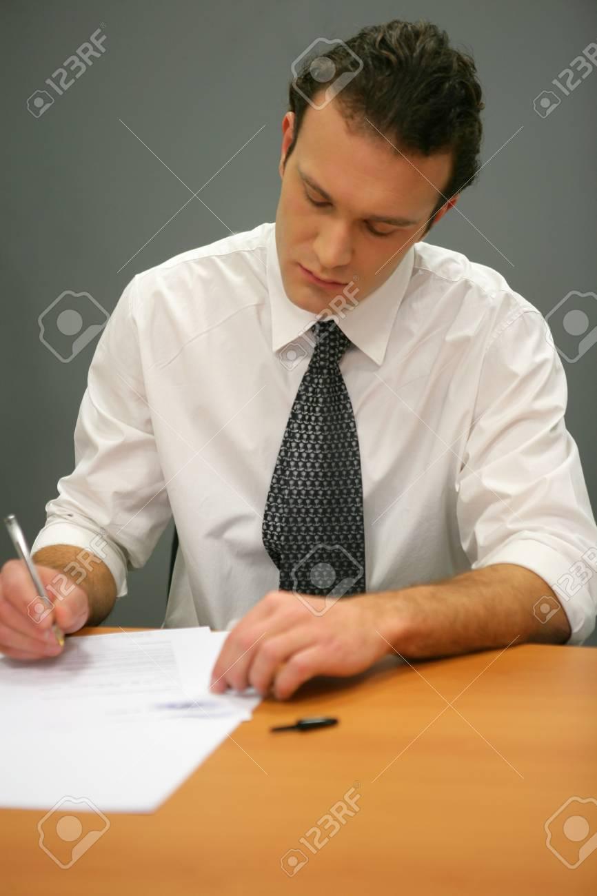 Businessman writing Stock Photo - 12250653