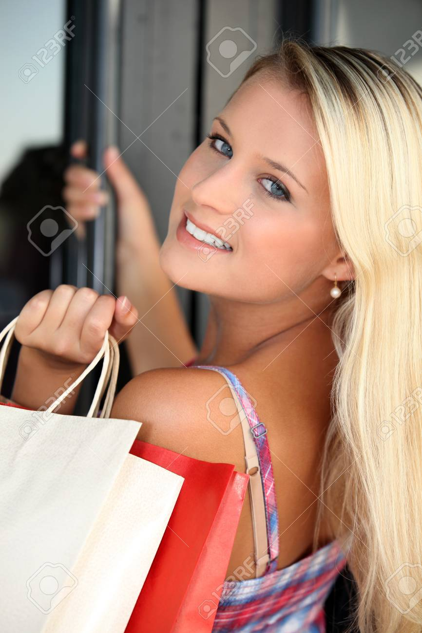 Blond teenager with shopping bags Stock Photo - 12251850
