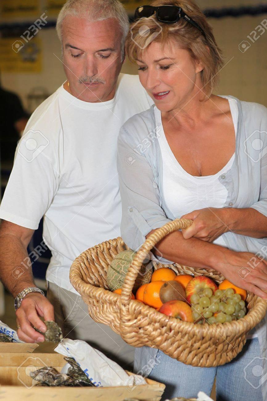 Couple shopping at the market Stock Photo - 12251910