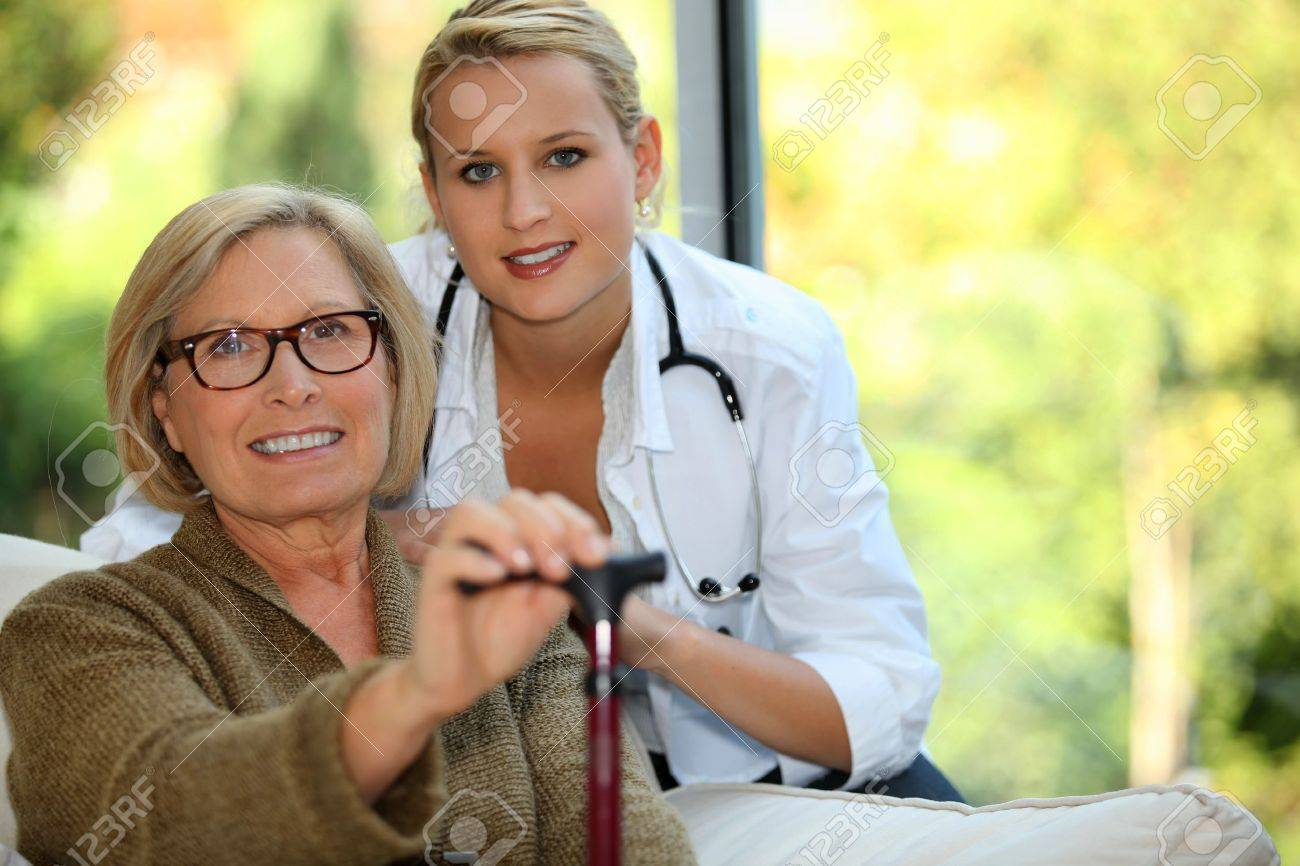 Older woman with a nurse Stock Photo - 12251692