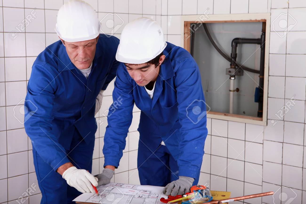 plumbers at work Stock Photo - 12302487