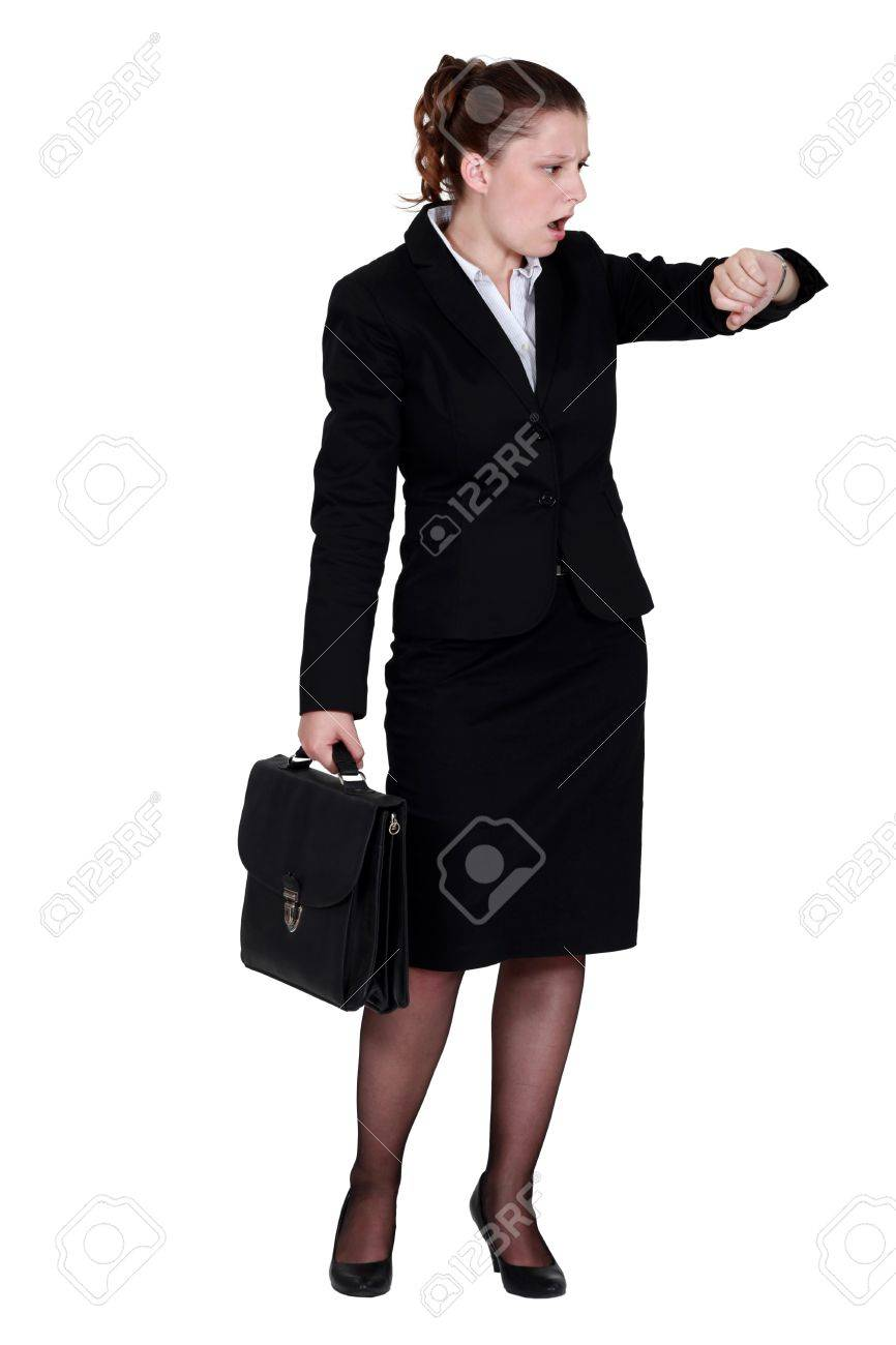 Businesswoman looking in shock at her watch Stock Photo - 12302230