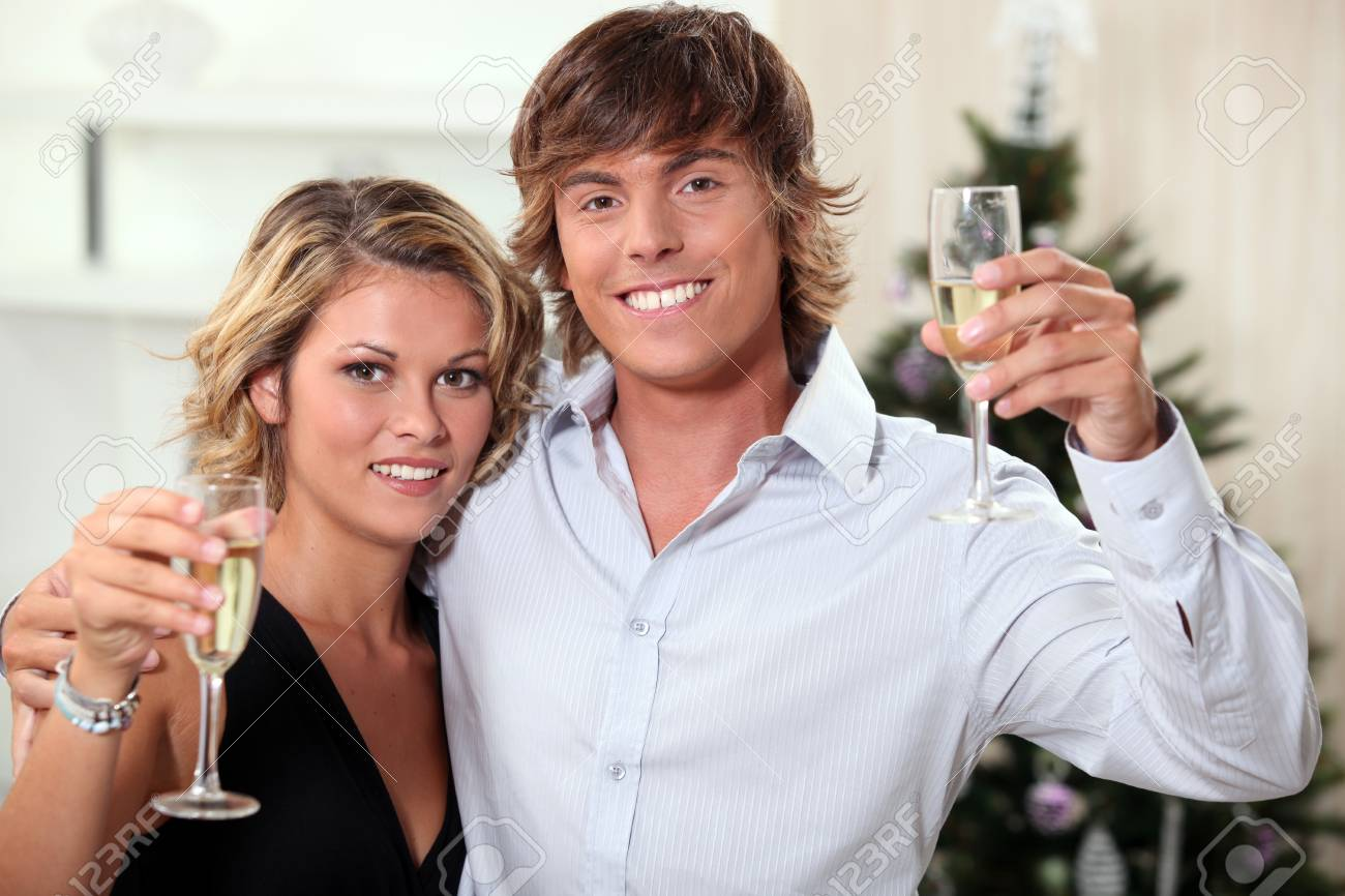 Young couple celebrating Christmas with champagne Stock Photo - 12367455