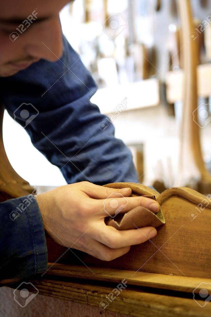 Young man sanding furniture Stock Photo - 12599972