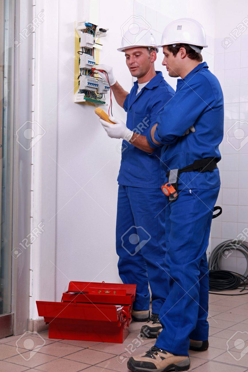 Two electricians checking power supply Stock Photo - 12596314