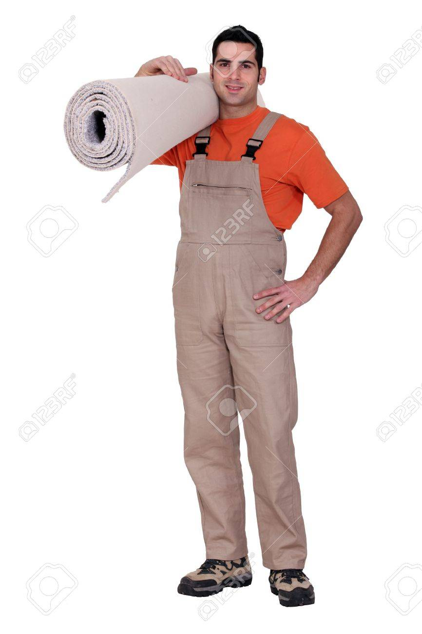 Man holding a roll of carpet Stock Photo - 12594852