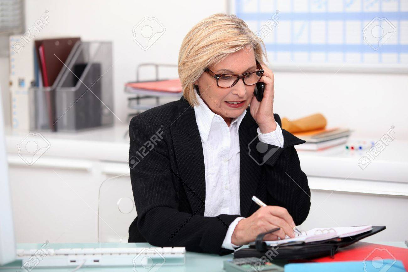 Woman on the phone in her office Stock Photo - 12636864