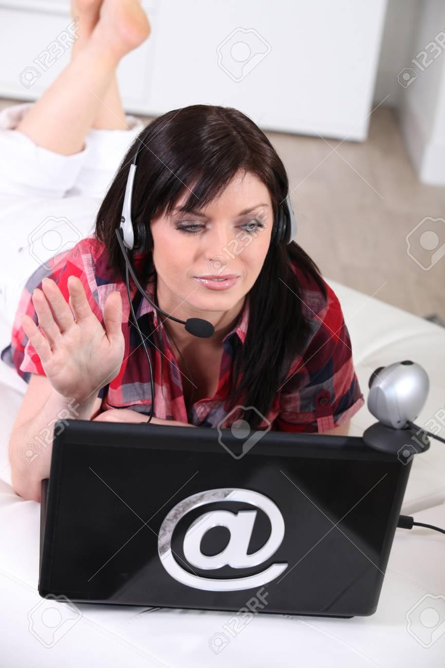 Woman talking on webcam — 11