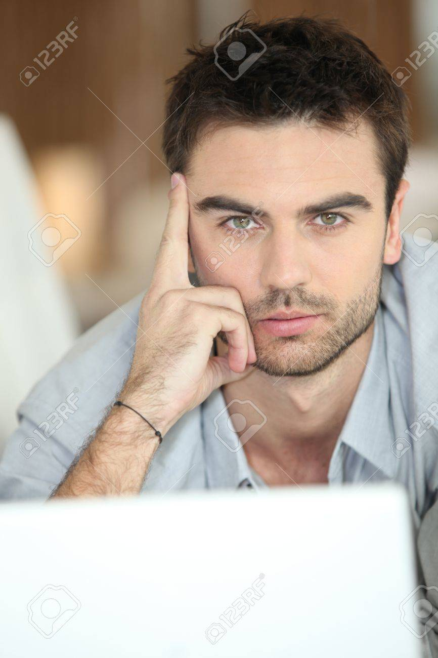 Relaxed man using laptop Stock Photo - 12600726