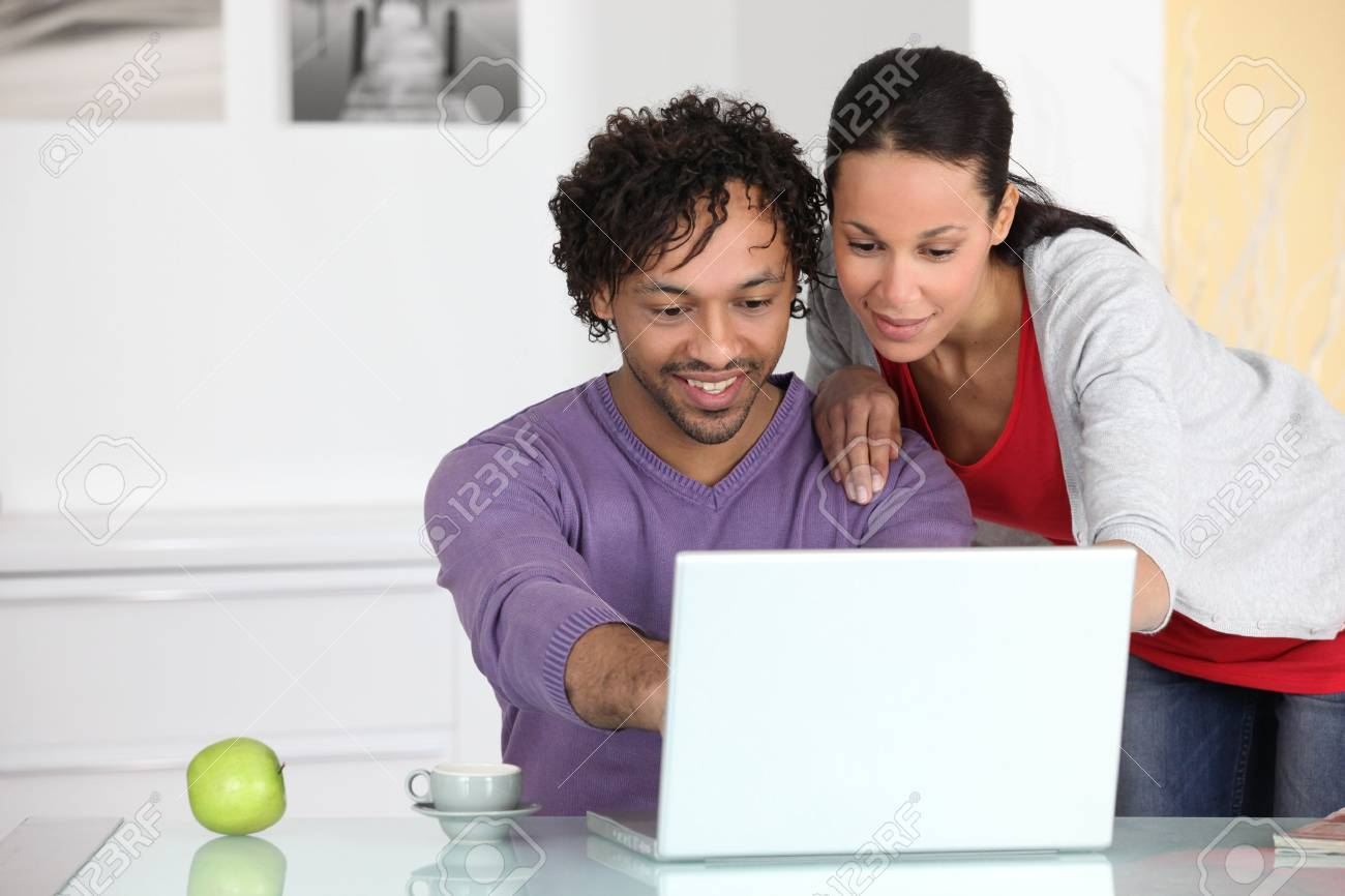couple having fun on Internet Stock Photo - 12637892