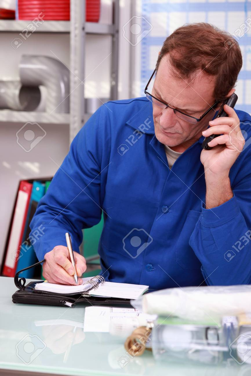 Workshop owner on the telephone Stock Photo - 12762514
