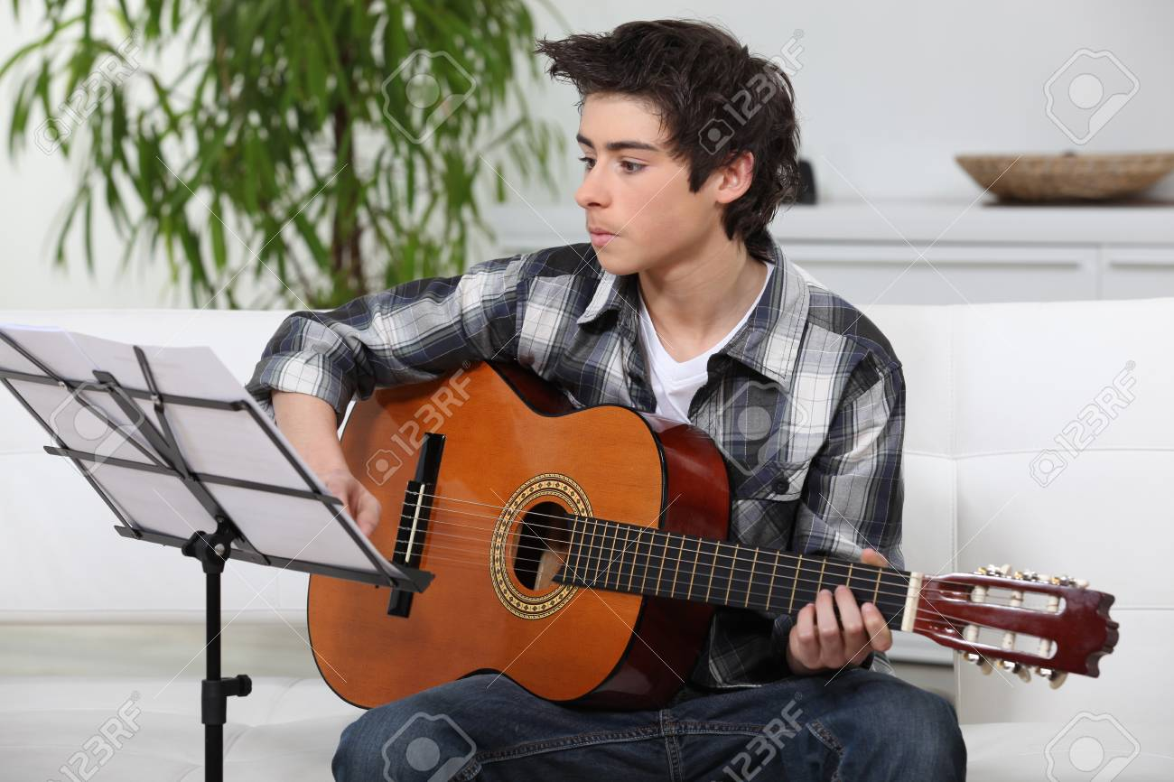 A young guitarist Stock Photo - 12597746