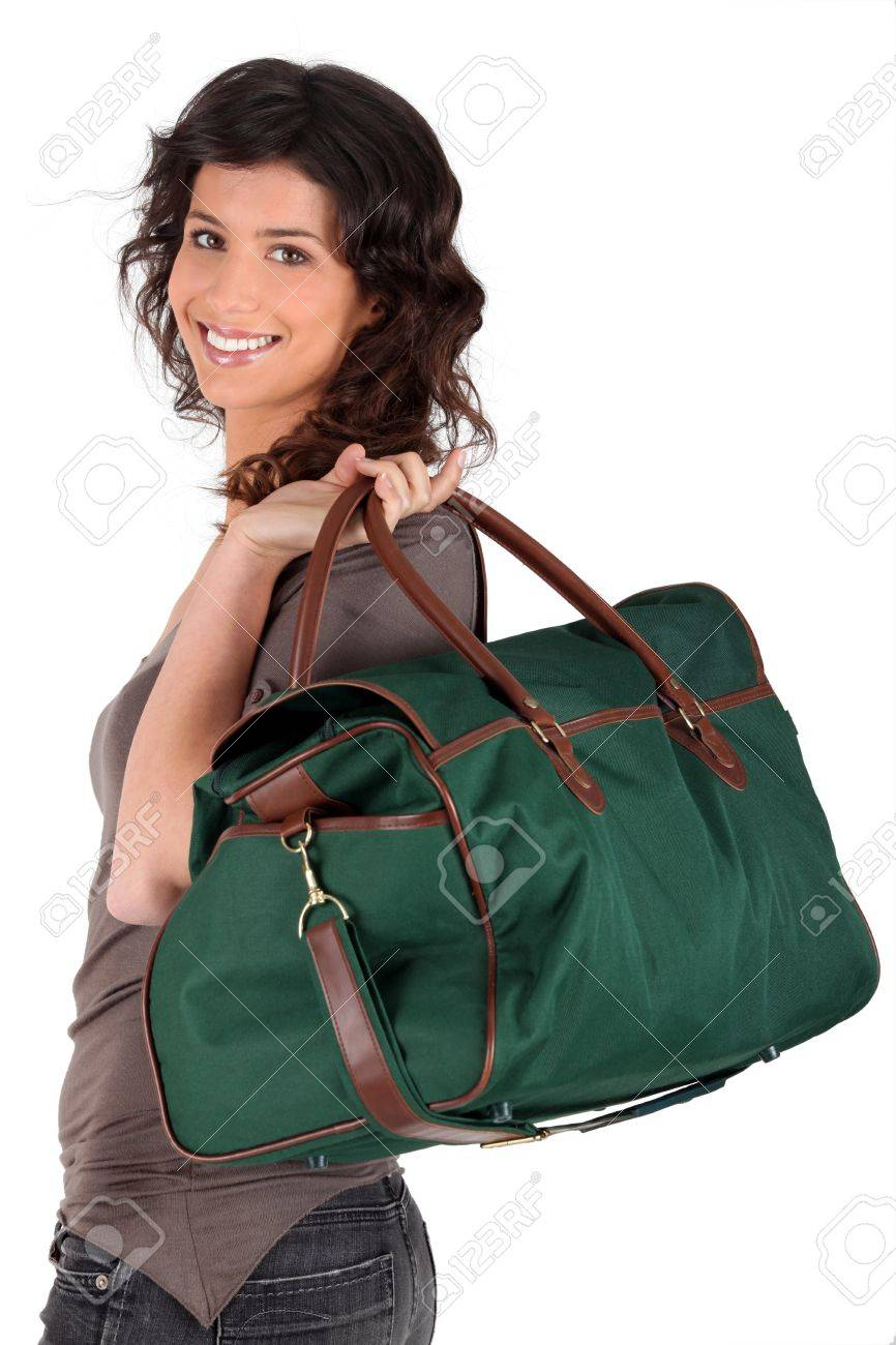 Woman carrying a weekend bag over her shoulder Stock Photo - 12580877