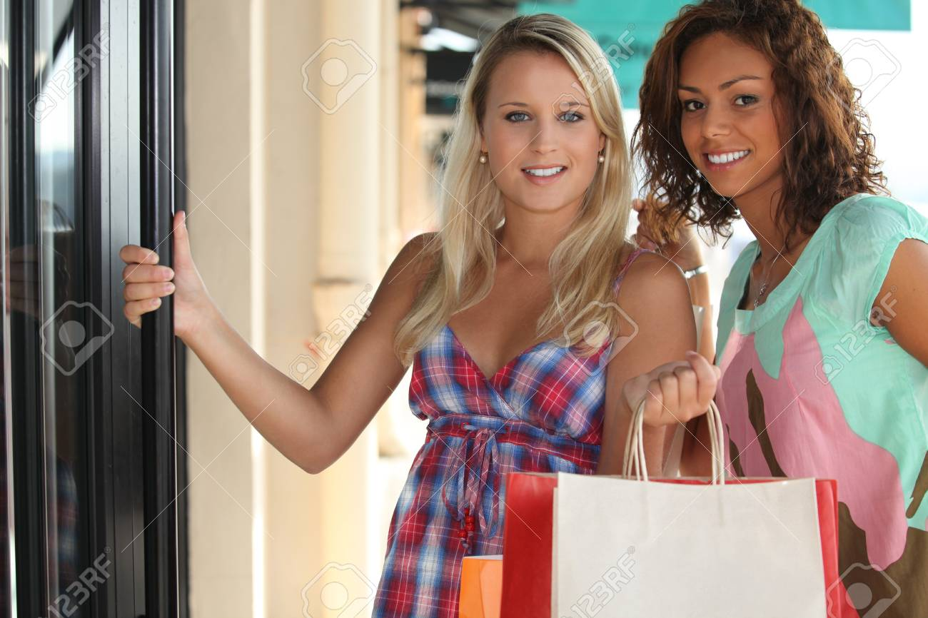 Portrait Of 2 Girls With Shopping Bags Stock Photo