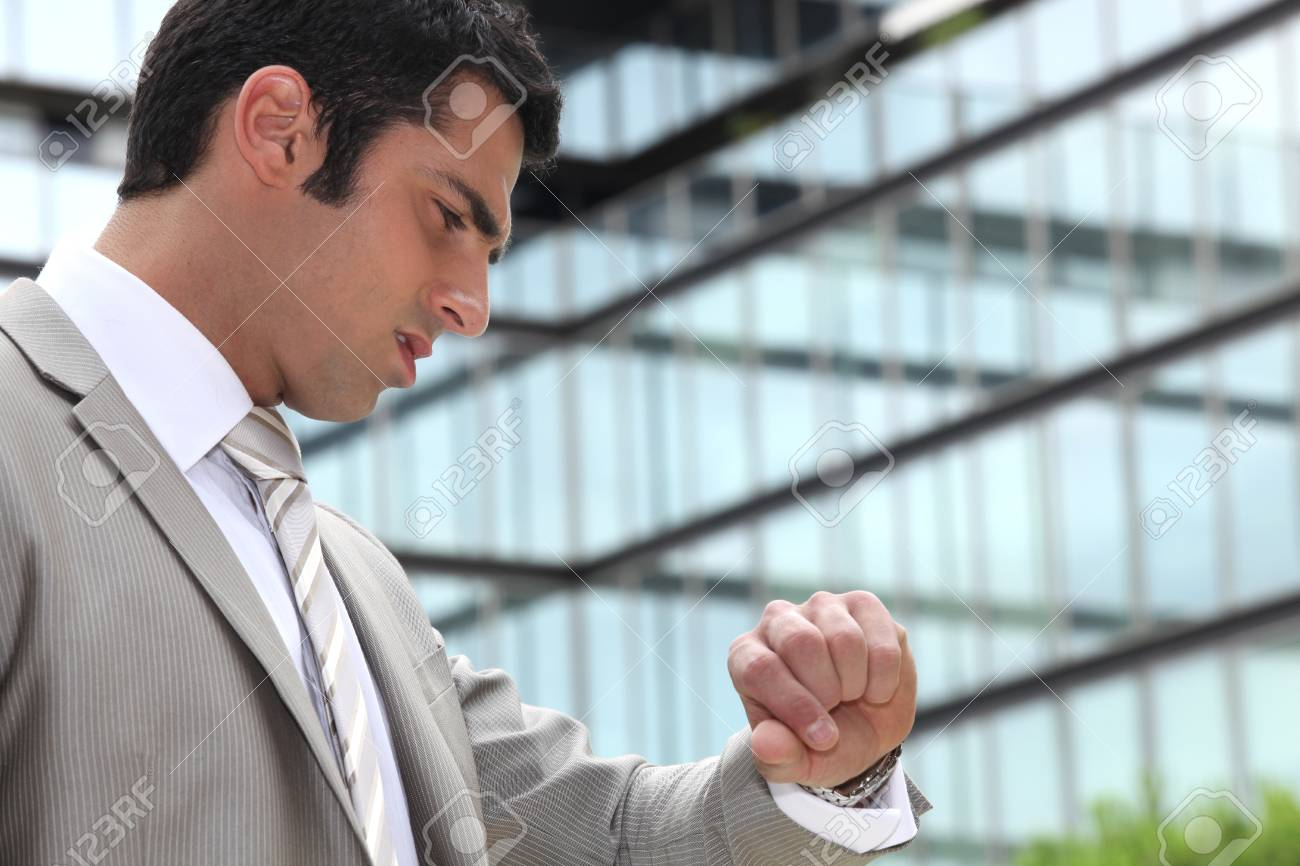 Businessman looking at his watch Stock Photo - 12728119