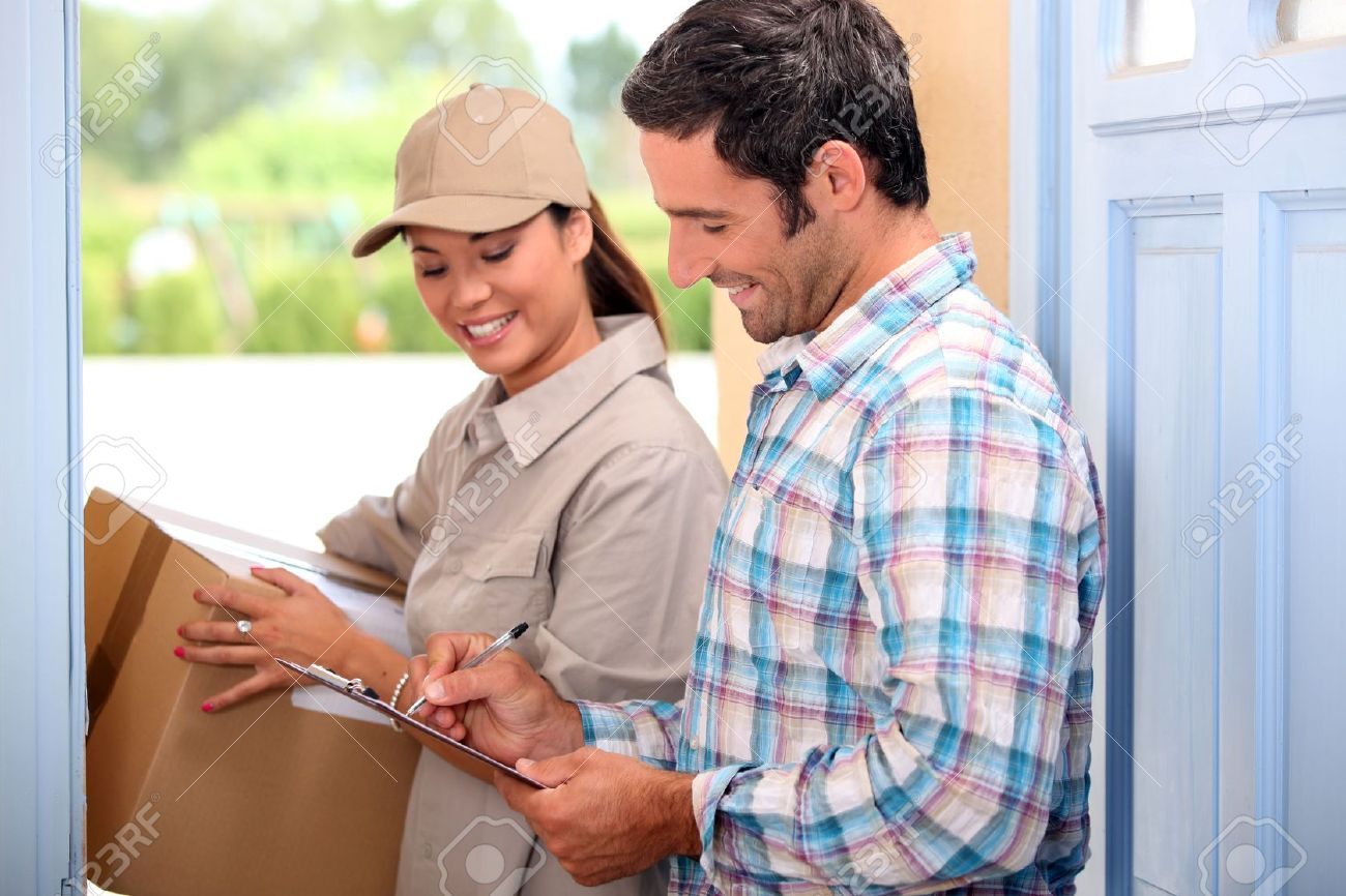 Man taking delivery of a parcel Stock Photo - 12721719