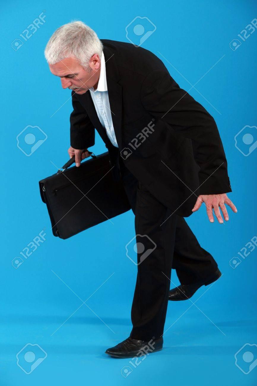 A mature businessman off balance Stock Photo - 12915236