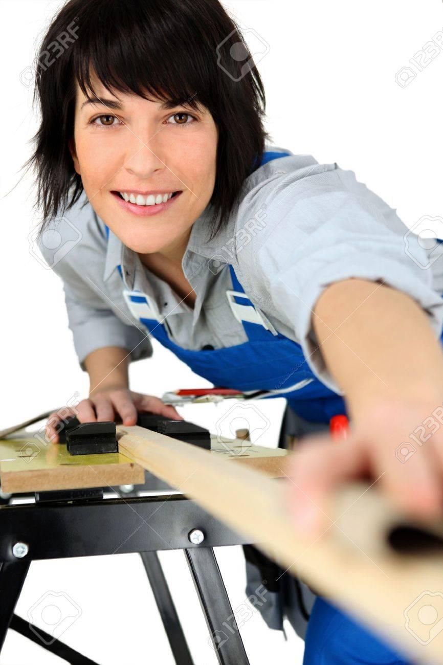 Female carpenter using workbench Stock Photo - 12479561