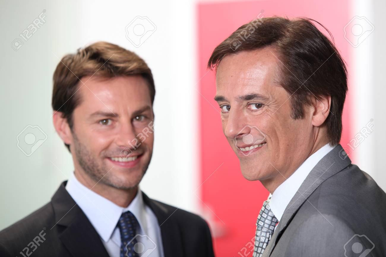 Two businessmen smiling Stock Photo - 12499885