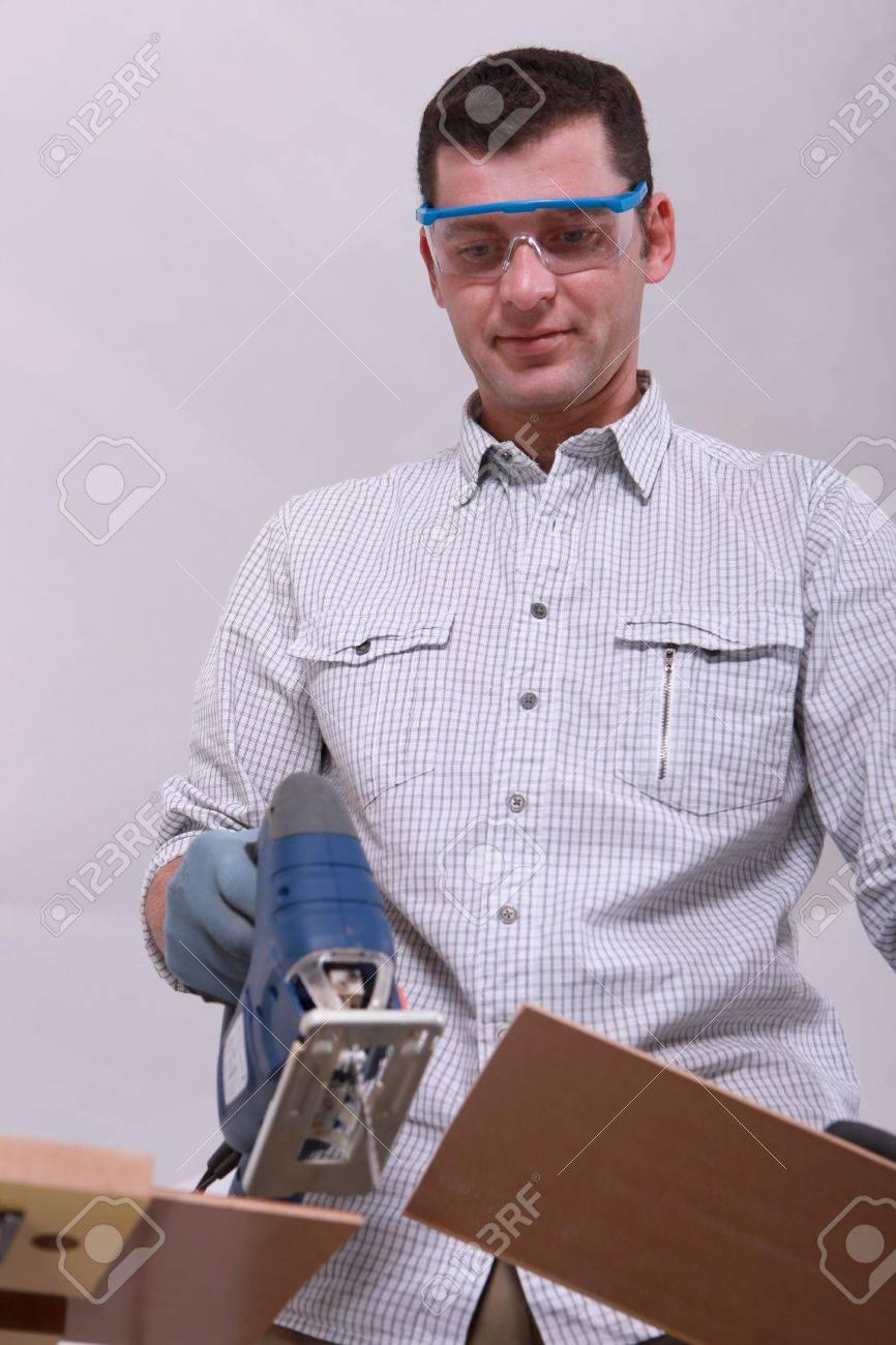 Man cutting a floorboard Stock Photo - 12529656