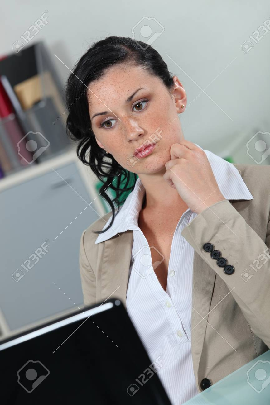 Secretary staring at her laptop Stock Photo - 13344113