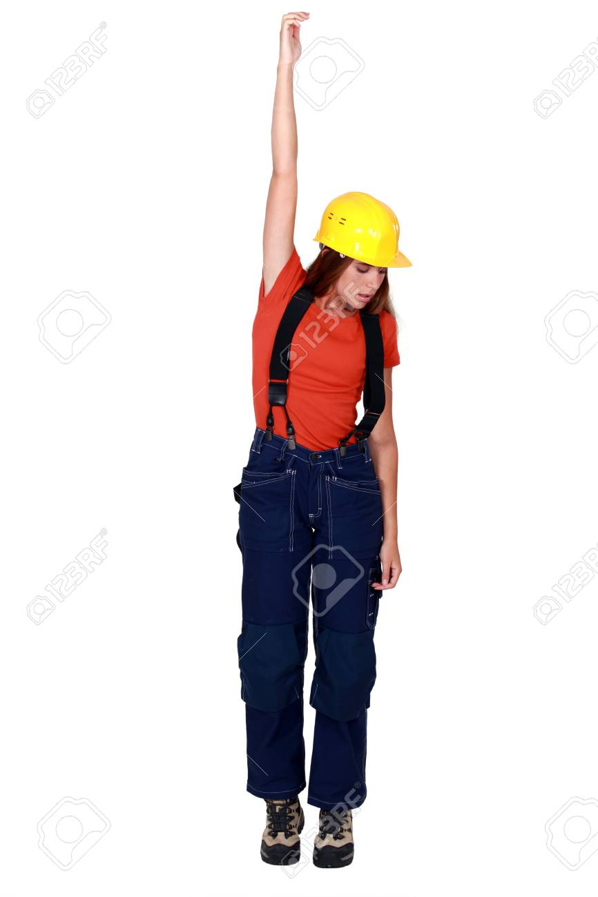 Tradeswoman being pulled up by an invisible object Stock Photo - 13343796