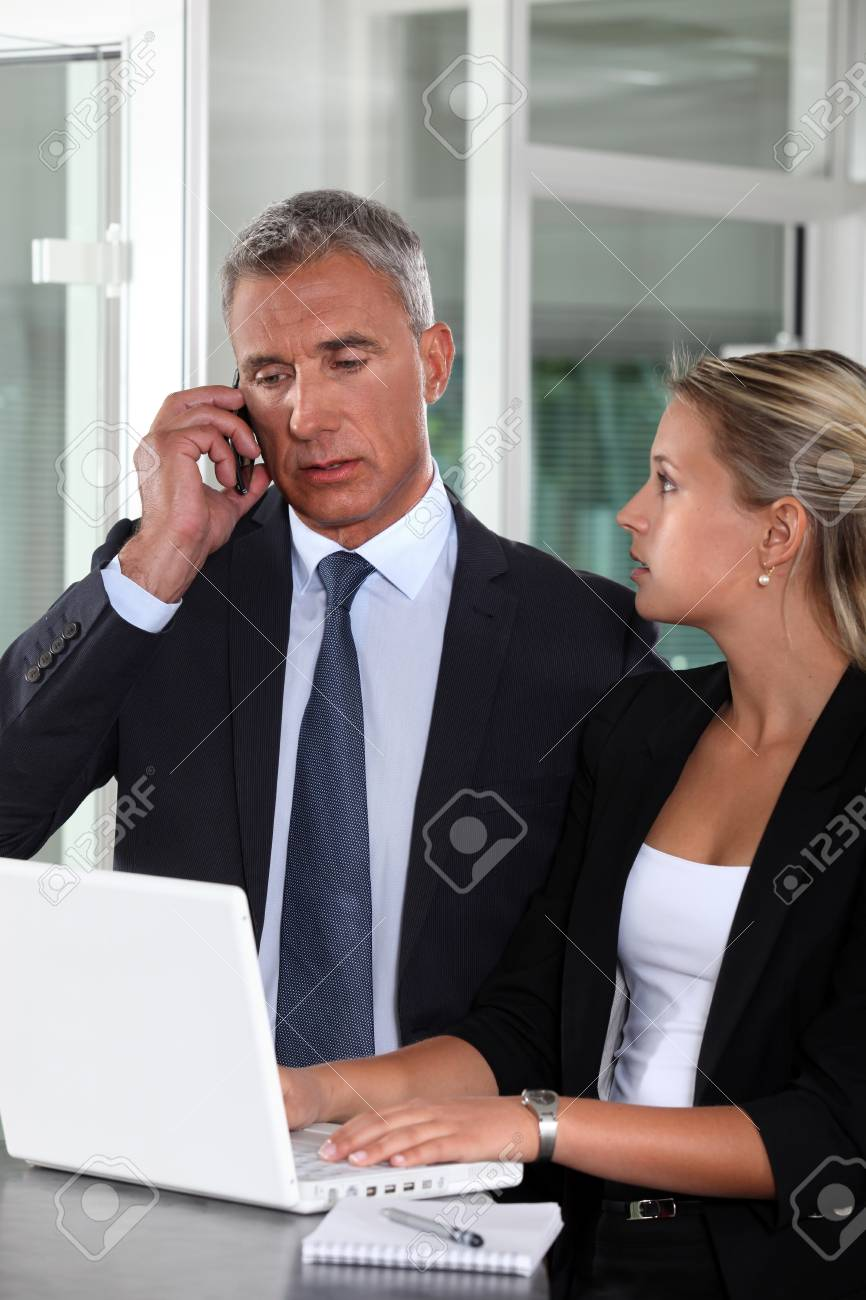 Boss working closely with female colleague Stock Photo - 13380399