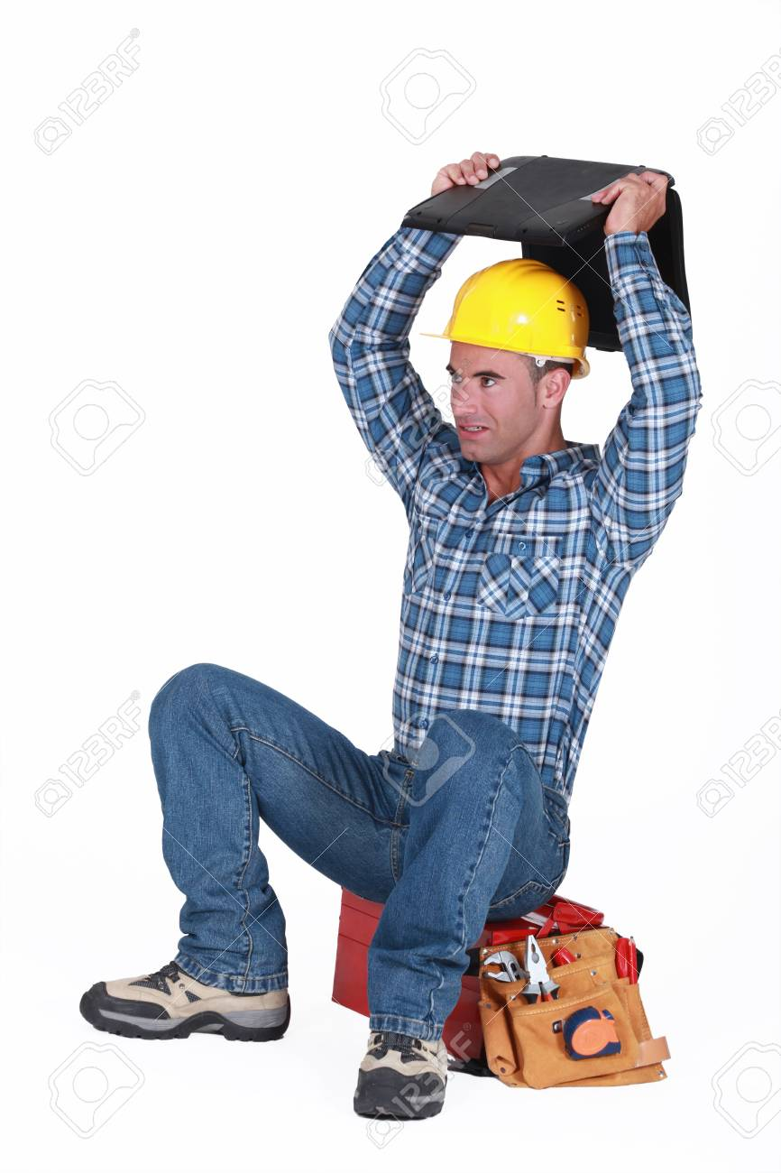 Artisan with computer sitting on top of the head Stock Photo - 13379703