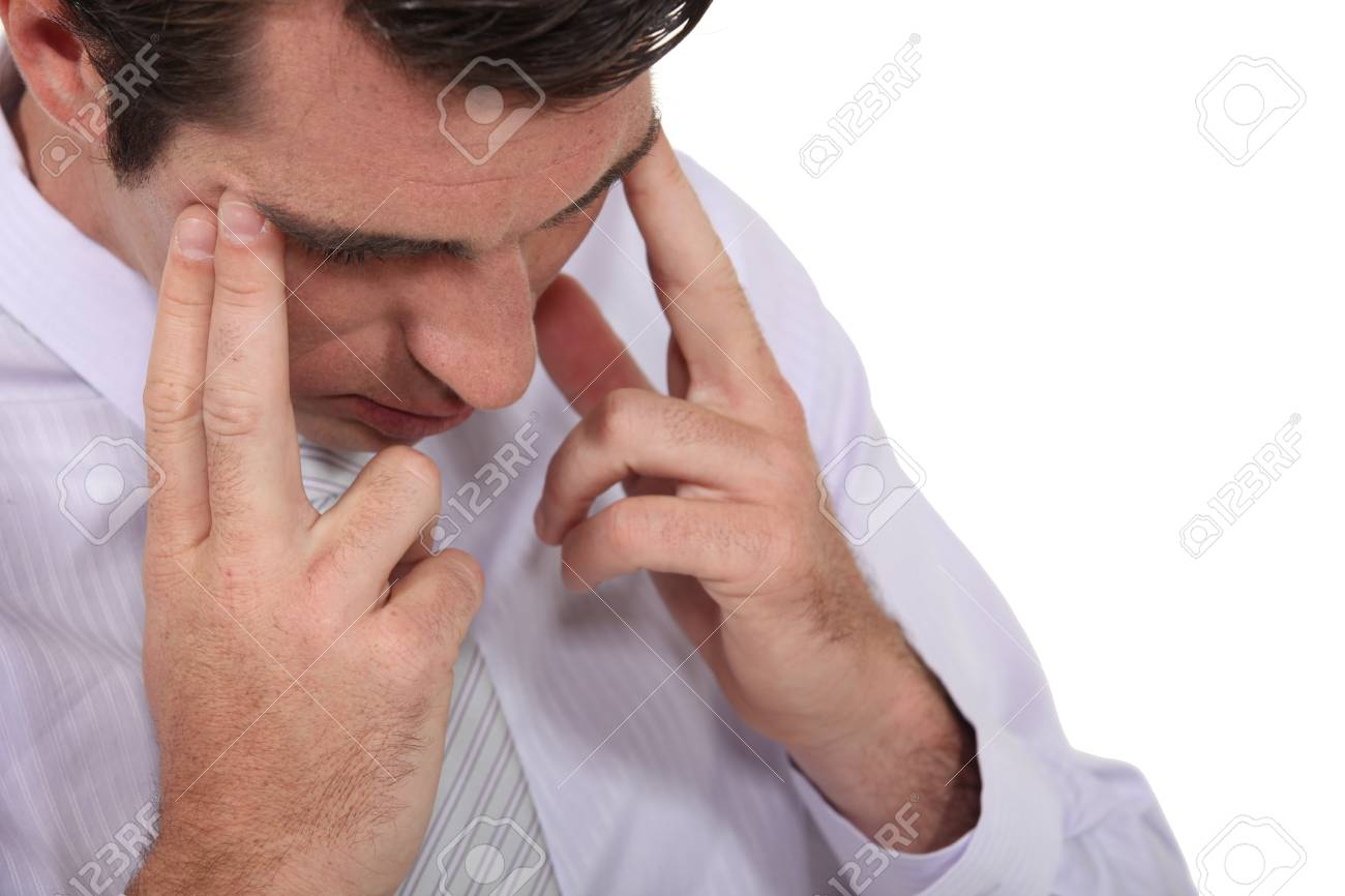 Businessman suffering from headache Stock Photo - 13379159