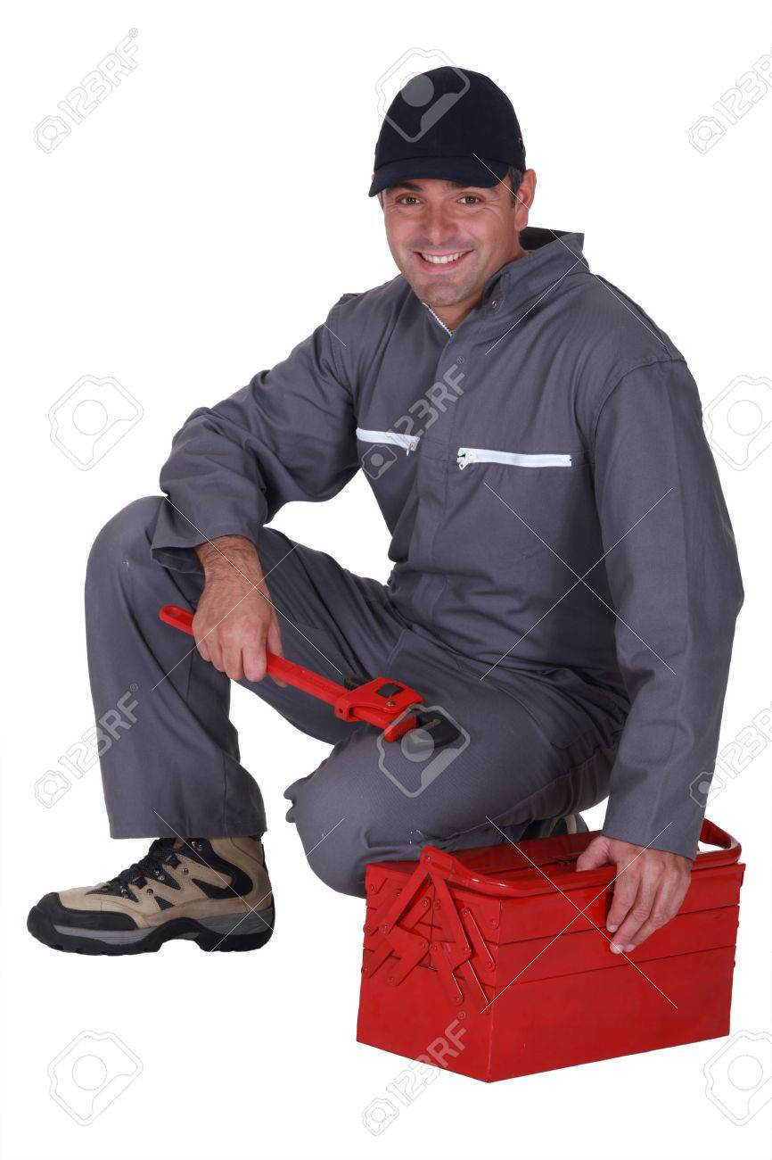 Worker sitting on a toolbox Stock Photo - 13379241