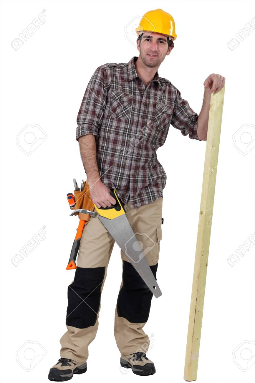 Tradesman with a saw and a wooden plank Stock Photo - 13459852