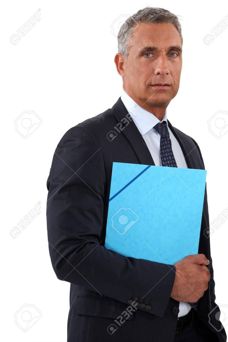 Businessman holding a blue folder Stock Photo - 13459535
