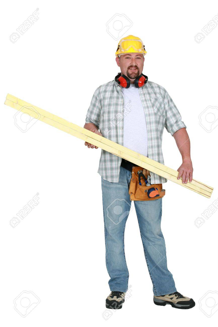 Tradesman carrying a plank of wood Stock Photo - 13460265